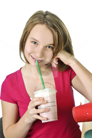 Teenage girl with milkshake stock photo, Teenage girl holding a cup with milkshake by Elena Elisseeva