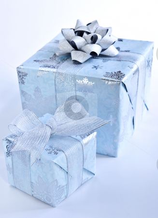 Christmas gift boxes stock photo, Two christmas gift boxes wrapped in blue paper with silver ribbon by Elena Elisseeva