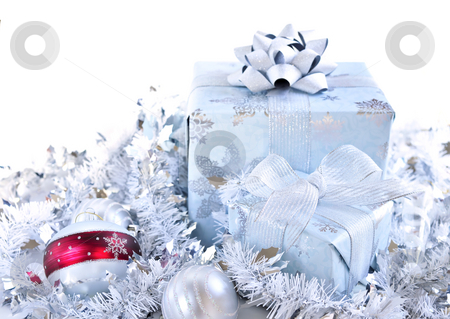 Christmas gift boxes stock photo, Two gift boxes with Christmas ornaments on white background by Elena Elisseeva