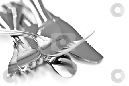 Cutlery stock photo, Forks and knifes isolated on white background by Elena Elisseeva