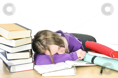 Teenage girl studying stock photo, Teenage girl studying at the desk being tired by Elena Elisseeva