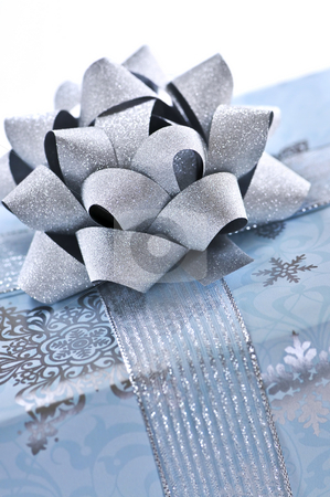 Christmas gift box stock photo, Wrapped christmas gift box close up on white background by Elena Elisseeva