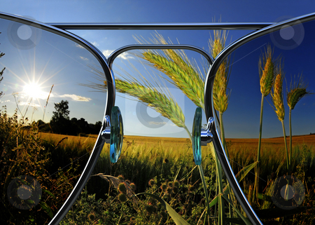 Through sunglasses stock photo, Beautiful landscape view through 3d rendered sunglasses by Magnus Johansson