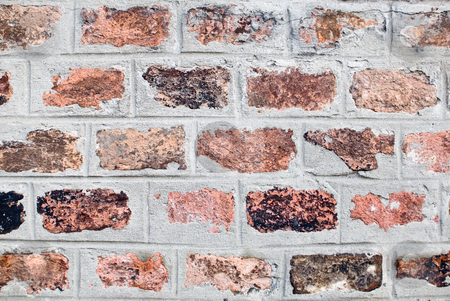 Arty bricks stock photo, A old and aged brickwall which consists of many different colors by Alexander L?