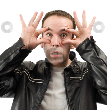 Wide Eyed stock photo, A young man wearing a leather jacket is holding his eyes open, isolated against a white background by Richard Nelson