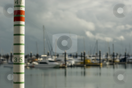 High Tide stock photo, Yachts sheltering in a marina with storm clouds. Concept of a 'storm surge' rising tide by Stephen Gibson