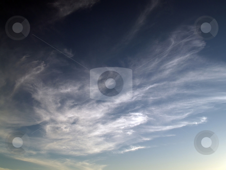 High mares tail clouds in gradiant sky light to dark stock photo, High clouds in sky going from light to dark by Jeff Cleveland