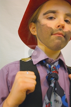 Girl dressed up as a cowboy stock photo, Little girl with painted face and suspenders by Gregory Dean