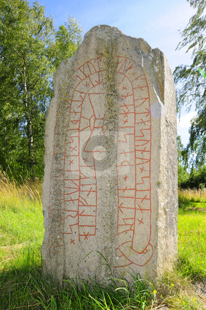 Rune stone_front stock photo, Ancient rune stone in Sweden by Magnus Johansson
