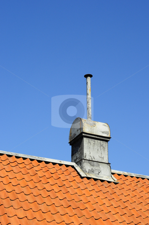Tin chimney stock photo, Different looking tin chimney on tile roof by Magnus Johansson