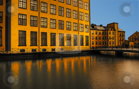 Yellow house stock photo, Old industry building by the water by Magnus Johansson