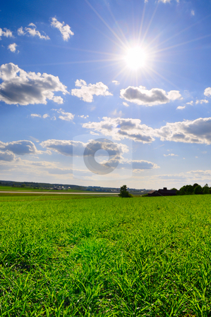 Under the sun stock photo, Sun over small city airport by Magnus Johansson
