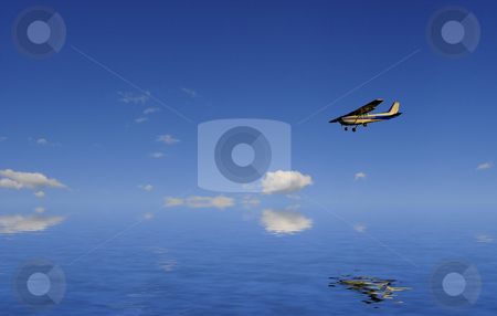 Flying over water stock photo, A plane is flying over calm reflecting ocean by Magnus Johansson
