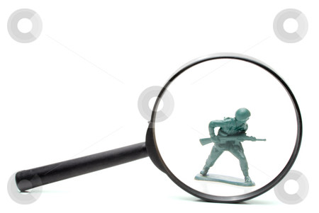 Army Man stock photo, A toy soldier being investigated under a magnifying glass. by Robert Byron