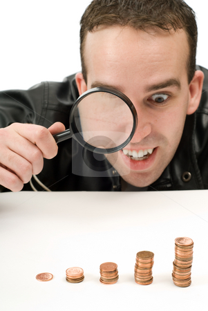 Rising Investments stock photo, A man watching his lucrative investments with a magnifying glass by Richard Nelson