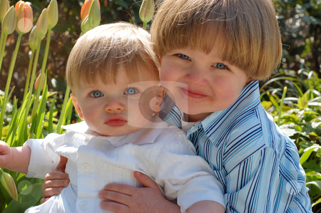 Holding Younger Brother - Horizontal stock photo, Outdoor horizontally framed shot of a young boy holding his baby brother. by Orange Line Media