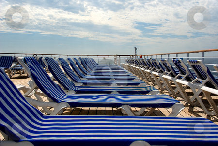 Row of Lounge Chairs stock photo, Row of lounge chairs on cruise ship by Randy Miramontez