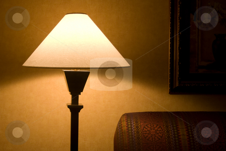 Lamp stock photo, Lamp with couch and painting in shadow by Randy Miramontez