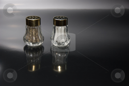 Salt and Pepper Shakers stock photo, Salt and pepper shakers with reflection in foreground by Randy Miramontez