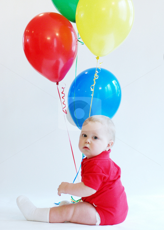 Toddler with Balloons stock photo, Portrait of a toddler boy wearing a red body-suit holding a bunch of balloons. by Orange Line Media