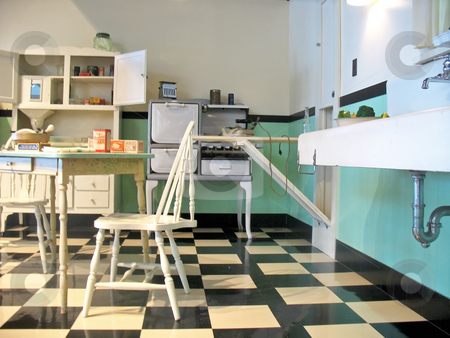 Vintage Kitchen stock photo, Shot of vintage kitchen with turquoise wall tiles and checkerboard black-n-white floor tiles. by Orange Line Media