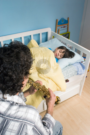 Father and Son - Vertical Format stock photo, Young father playing his song a son to get him to go to sleep by Orange Line Media
