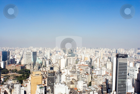 City View with Blue Sky stock photo, A city view of many buildings with a blue sky. by Orange Line Media