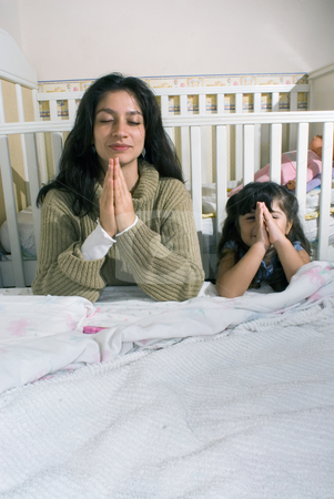 Mother and Daughter Saying Bedtime Prayers - Vertical stock photo, Mother by Orange Line Media
