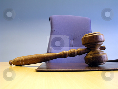 Gavel stock photo, A gavel on wood desk in court by Ingvar Bjork