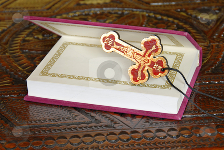Religious life stock photo, Russian New Testament opened book with wooden cross by Julija Sapic