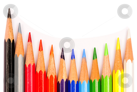 Crayons stock photo, A curved row of coloured pencils on a white background. by Alistair Scott