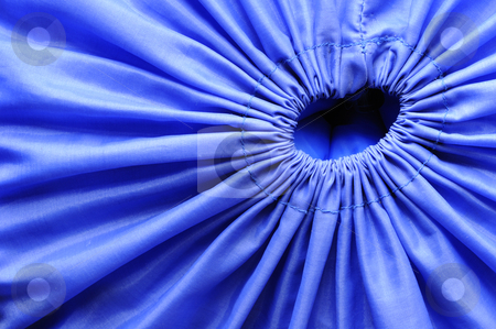Opening stock photo, Macro image of the opening of a blue fabric bag, drawn tight closed by a drawstring. by Alistair Scott