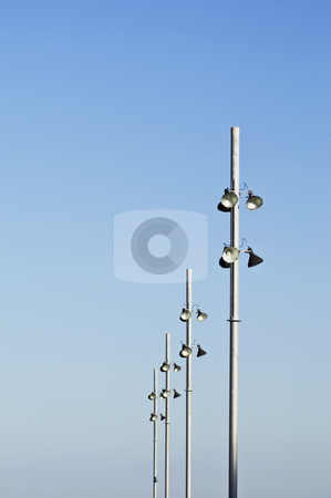 Streetlight stock photo, Modern streetlights against a clear blue sky by Manuel Ribeiro