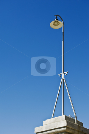 Streetlight stock photo, Retro streetlight against a clear blue sky by Manuel Ribeiro