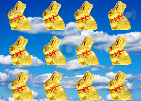 Golden chocolate Easter bunnies stock photo, Twelve isolated golden chocolate Easter bunnies by Christopher Meder