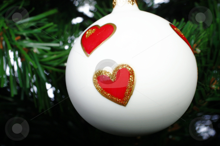 Christmas decoration stock photo, Glass Christmas decoration on a green tree by Christopher Meder
