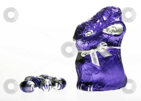 Chocolate Easter bunny with eggs stock photo, Chocolate Easter bunny with eggs isolated with area for text by Christopher Meder