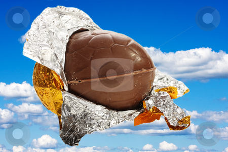 Easter egg opened in gold foil stock photo, Isolated Easter egg opened in gold foil by Christopher Meder