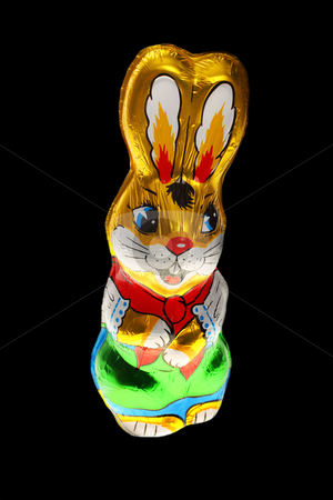 chocolate Easter bunn stock photo, A golden chocolate Easter bunny isolated with area for text by Christopher Meder