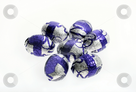 Purple chocolate Easter eggs stock photo, Purple chocolate Easter eggs isolated with area for text by Christopher Meder