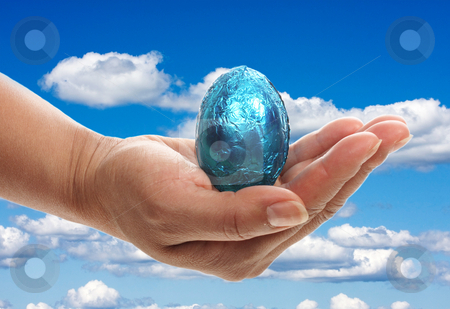 Blue Easter egg stock photo, Blue Easter egg held by a women by Christopher Meder