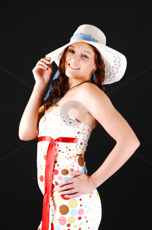 Pretty girl with white hat. stock photo, Lovely woman in an colorful dress and a white hat smiling in the camera shooing her nice figure, for black background. by Horst Petzold