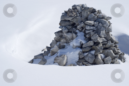 Heap stock photo, Heap of stone emerging from snow by Serge VILLA