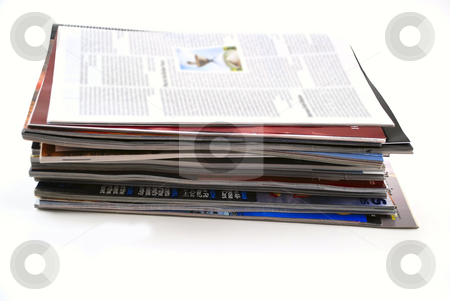 Newspapers and magazines stock photo, Stock pictures of a stack of newspapers or magazines by Albert Lozano