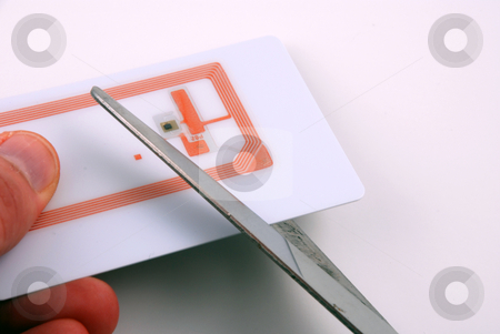 Cutting rfid transponders and tags stock photo, Representation of privacy concers brought up by the use of rfid by Albert Lozano
