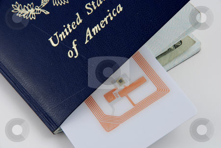Safety trhough rfid stock photo, Pictures of a rfid tag embedded in a passport for safety purposes by Albert Lozano