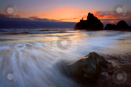 Waves of Color stock photo, Ebbing tides surround a boulder on Ruby Beach at sunset by Mike Dawson