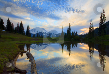 Rainier Cloud Explosion stock photo, Mt. Rainier reflects in the still waters of a small alpine lake at sunset. by Mike Dawson