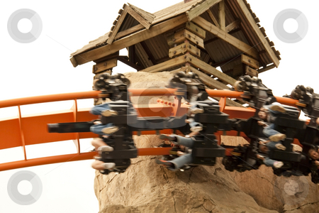 People on Roller Coaster stock photo, People on a roller coaster going past at speed by Chris Alleaume
