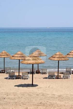 Sun Umbrellas stock photo, Thatched sun shades on a deserted beach on Zante (Zakynthos) by Helen Shorey